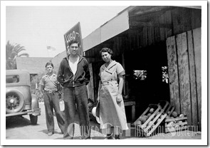 Lugo Ranch Corn Stand, with Georgie Lugo, background, with his Uncle Charlie Lugo, and Auntie Vicenta Lugo