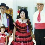 "ClaritaFiesta: Clarita Marquez Young, the Historical Society's ""Madrina"" continued dressing for the Fiestas into the '80s.  She is flanked here by a Machado and two Lugo descendants, Charles Lugo and Michele Cerra."