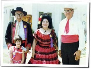 "Clarita Marquez Young, the Historical Society's ""Madrina"" continued dressing for the Fiestas into the '80s. She is flanked here by a Machado and two Lugo descendants, Charles Lugo and Michele Cerra. - Culver City Historical Society"