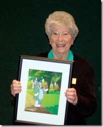Martha Sigall holds the cel she created for the event - Culver City Historical Society